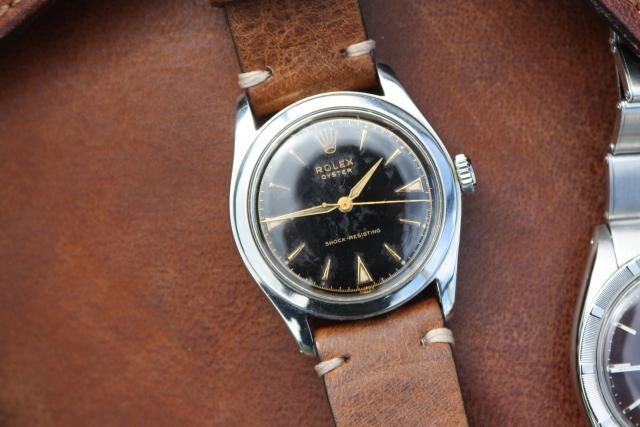 black rolex gilt dial