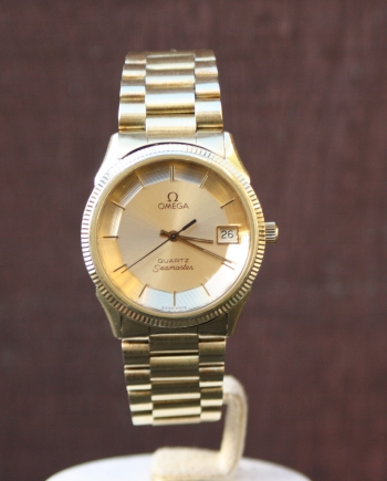 solid gold omega