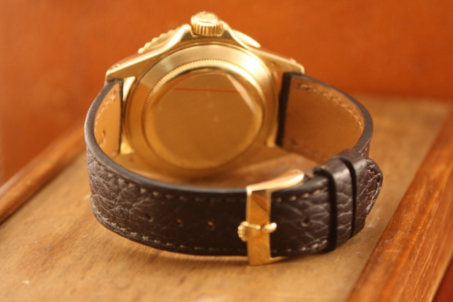 gold submariner on leather